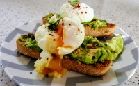 Good for breakfast, brunch or lunch - my favourite - poached eggs and smashed avocado on sourdough toast