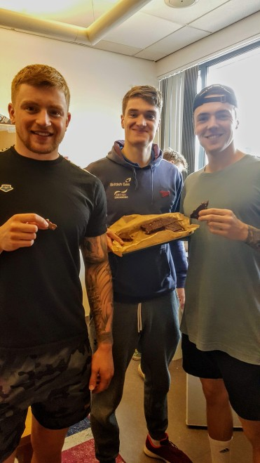 The boys enjoying my post-swim snacks (L-R Adam Peaty, James Wilby and Jarvis Parkinson)